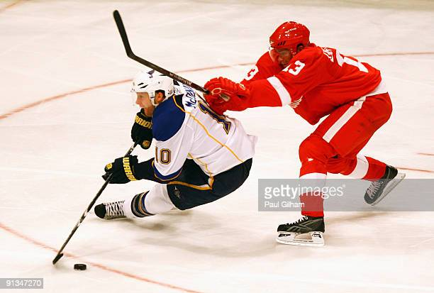 Andy McDonald of St Louis BLues battles for the puck with Pavel Datsyuk of Detroit Red Wings during the 2009 Compuware NHL Premiere Stockholm match...
