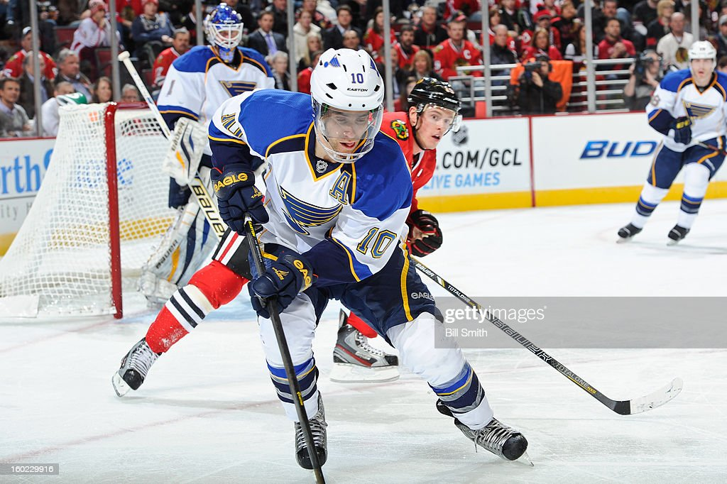 Andy McDonald #10 of the St. Louis Blues approaches the puck during the NHL game against the Chicago Blackhawks on January 22, 2013 at the United Center in Chicago, Illinois.