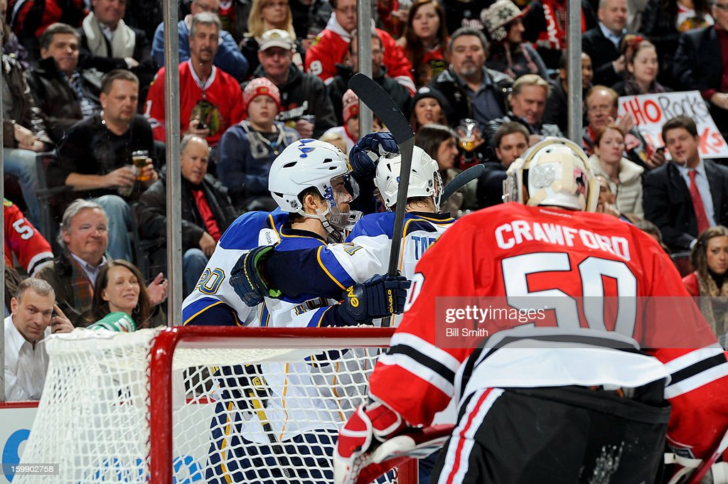 Andy McDonald #10 of the St. Louis Blues celebrates with teammates after scoring against the Chicago Blackhawks in the third during the NHL game on January 22, 2013 at the United Center in Chicago, Illinois.