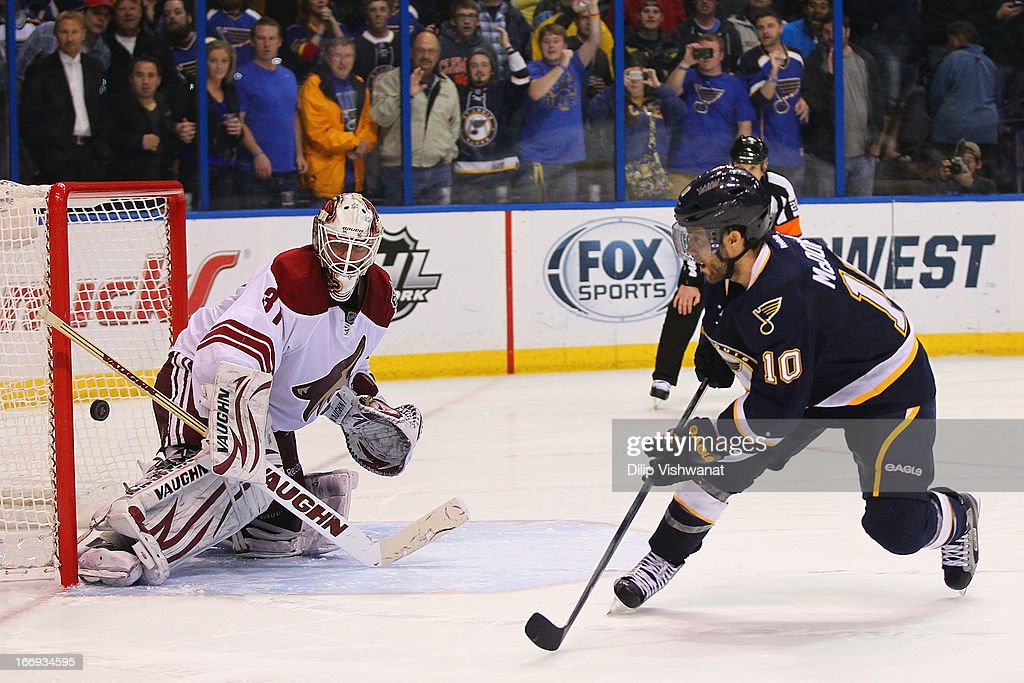 Andy McDonald #10 of the St. Louis Blues scores the game-winning goal against Chad Johnson #31 of the Phoenix Coyotes during the shoot out at the Scottrade Center on April 18, 2013 in St. Louis, Missouri. The Blues beat the Coyotes 2-1 in a shootout.