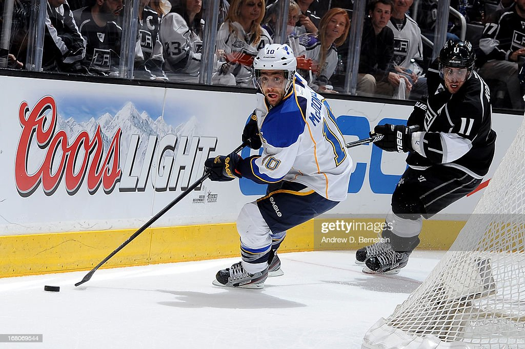Andy McDonald #10 of the St. Louis Blues skates with the puck against Anze Kopitar #11 of the Los Angeles Kings in Game Three of the Western Conference Quarterfinals during the 2013 NHL Stanley Cup Playoffs at Staples Center on May 4, 2013 in Los Angeles, California.