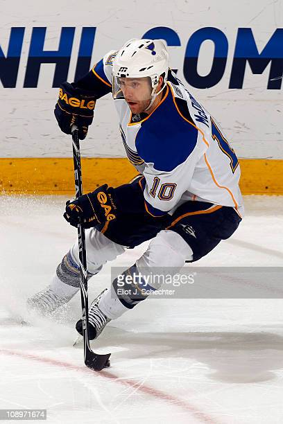 Andy McDonald of the St Louis Blues skates with the puck against the Florida Panthers at the BankAtlantic Center on February 8 2011 in Sunrise Florida