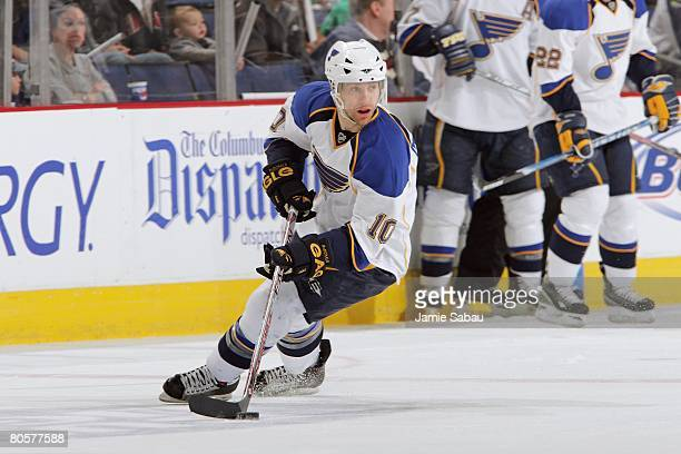 Andy McDonald of the St Louis Blues skates with the puck against the Columbus Blue Jackets on April 6 2008 at Nationwide Arena in Columbus Ohio