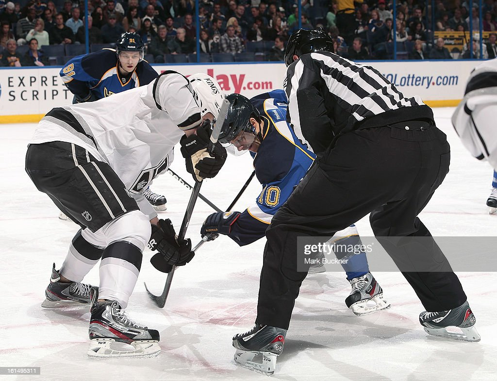 Andy McDonald #10 of the St. Louis Blues takes a face-off against a player from the Los Angeles Kings in an NHL game on February 11, 2013 at Scottrade Center in St. Louis, Missouri.
