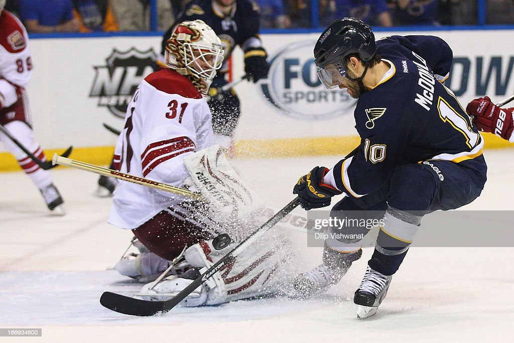 Andy McDonald #10 of the St. Louis Blues takes a shot on goal against Chad Johnson #31 of the Phoenix Coyotes in the third period at the Scottrade Center on April 18, 2013 in St. Louis, Missouri. The Blues beat the Coyotes 2-1 in a shootout.