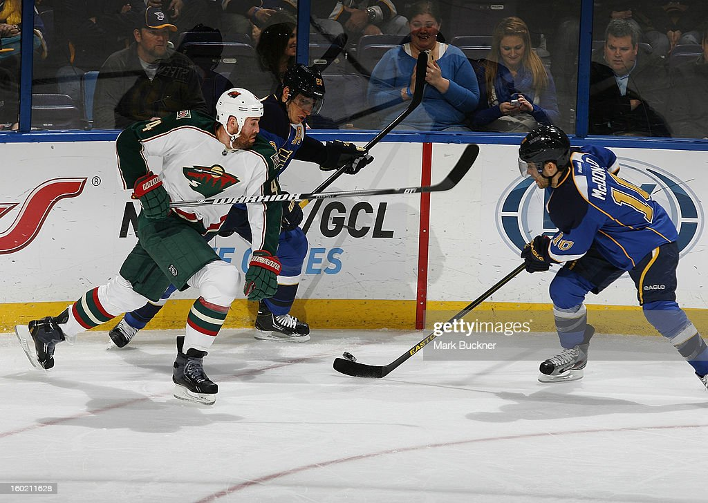 Andy McDonald #10 of the St. Louis Blues tries to slide the puck past <a gi-track='captionPersonalityLinkClicked' href=/galleries/search?phrase=Clayton+Stoner&family=editorial&specificpeople=2222214 ng-click='$event.stopPropagation()'>Clayton Stoner</a> #4 of the Minnesota Wild in an NHL game on January 27, 2013 at Scottrade Center in St. Louis, Missouri.