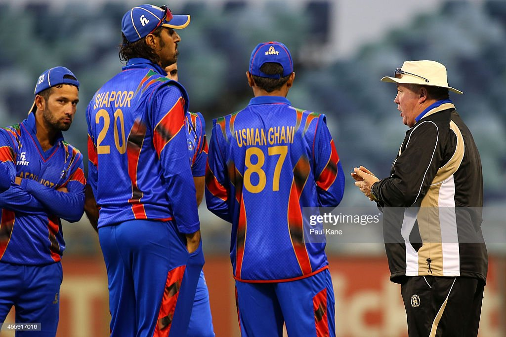 Andy Moles, head coach of Afghanistan talks with his palyers during the One Day friendly match between the Western Australia XI and Afghanistan at WACA on September 22, 2014 in Perth, Australia.