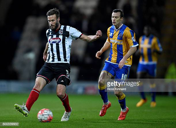 Andy Monkhouse of Grimsby is challenged by Shaun Whalley of Shresbury during the Emirates FA Cup second round match between Grimsby Town and...