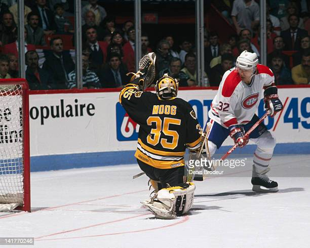 Andy Moog of the Boston Bruins makes a glove save on Claude Lemieux of the Montreal Canadiens Circa 1980 at the Montreal Forum in Montreal Quebec...