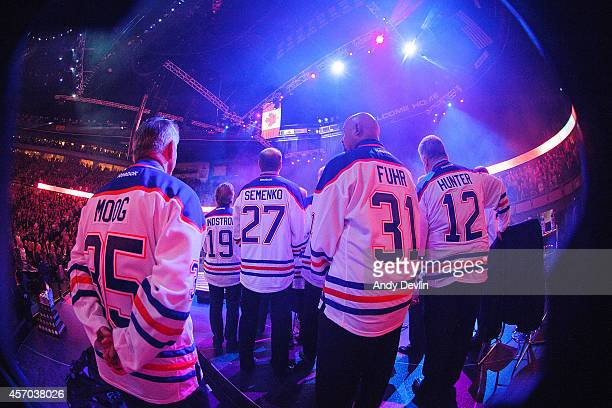 Andy Moog Willy Lindstrom Dave Semenko Grant Fuhr and Dave Hunter during the Edmonton Oilers Stanley Cup Reunion at Rexall Place on October 10 2014...
