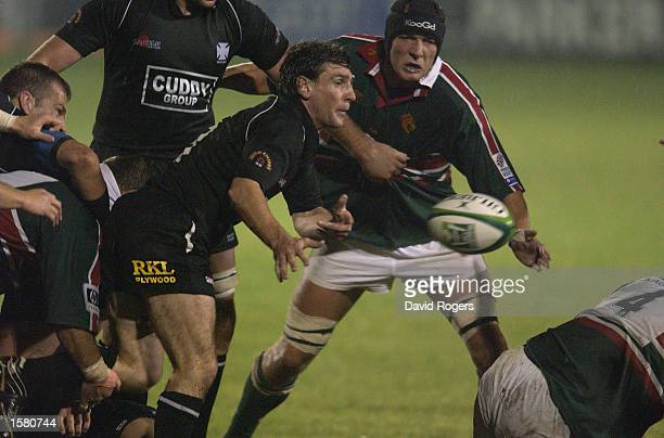 Andy Moore of Neath gets the ball away as Ben Kay of Leicester Tigers closes in during the Heineken Cup Pool 1 match held on October 11 2002 at the...