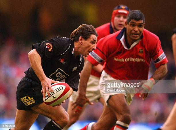 Andy Moore of Neath races past Jim Williams of Munster during the Celtic League Final between Neath and Munster at the Millennium Stadium Cardiff...
