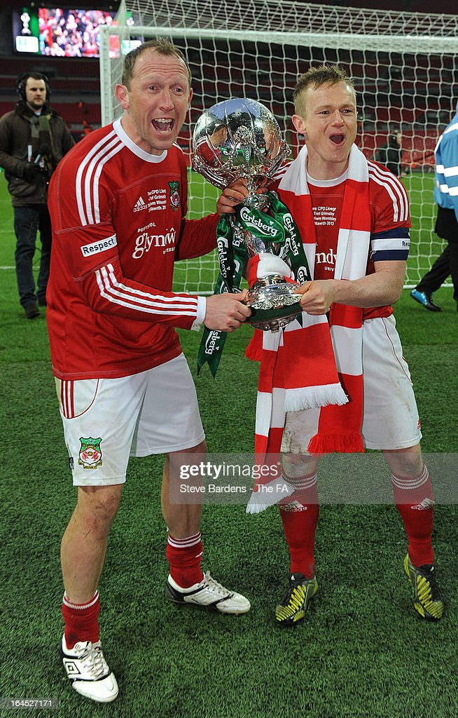 Andy Morrell and Dean Keates of Wrexham celebrate their victory with FA Trophy after the FA Trophy Final between Wrexham and Grimsby Town at Wembley Stadium on March 24, 2013 in London, England.