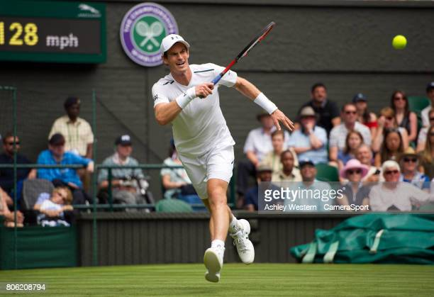 Andy Murray [1] of Great Britain in action against Alexander Bublik of Kazakhstan in their Men's Singles First Round Match at All England Lawn Tennis...