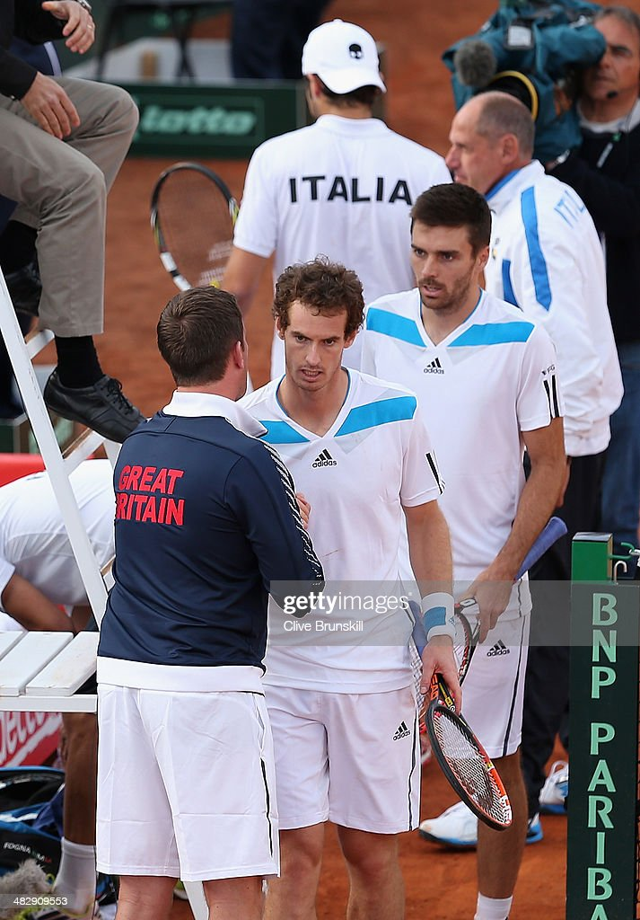 Andy Murray and Colin Fleming of Great Britain are congratulated by their team captain <a gi-track='captionPersonalityLinkClicked' href=/galleries/search?phrase=Leon+Smith+-+Tennis+Coach&family=editorial&specificpeople=12698515 ng-click='$event.stopPropagation()'>Leon Smith</a> after their four set victory in the doubles third rubber against Simone Bolelli and Fabio Fognini of Italy during day two of the Davis Cup World Group Quarter Final match between Italy and Great Britain at Tennis Club Napoli on April 5, 2014 in Naples, Italy.