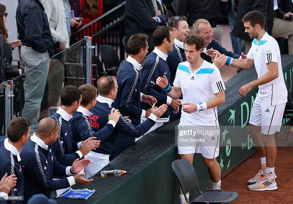 Andy Murray and Colin Fleming of Great Britain are congratulated by their team mates after their four set victory in the doubles third rubber against Simone Bolelli and Fabio Fognini of Italy during day two of the Davis Cup World Group Quarter Final match between Italy and Great Britain at Tennis Club Napoli on April 5, 2014 in Naples, Italy.