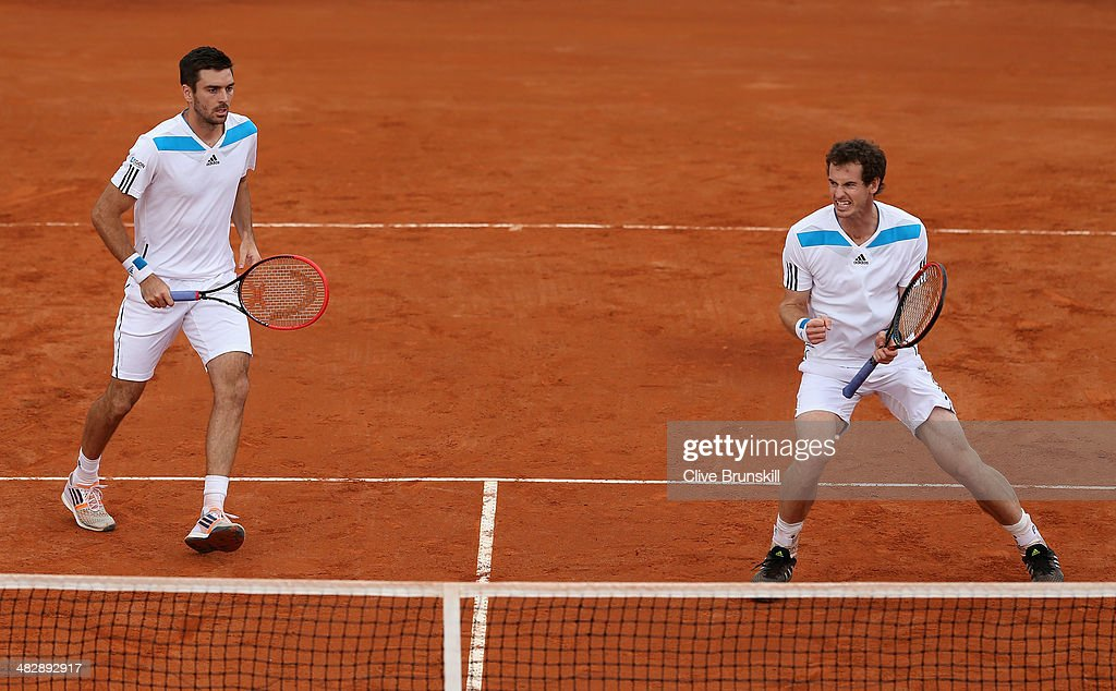 Andy Murray and Colin Fleming of Great Britain celebrate a point against Simone Bolelli and Fabio Fognini of Italy during day two of the Davis Cup World Group Quarter Final match between Italy and Great Britain at Tennis Club Napoli on April 5, 2014 in Naples, Italy.