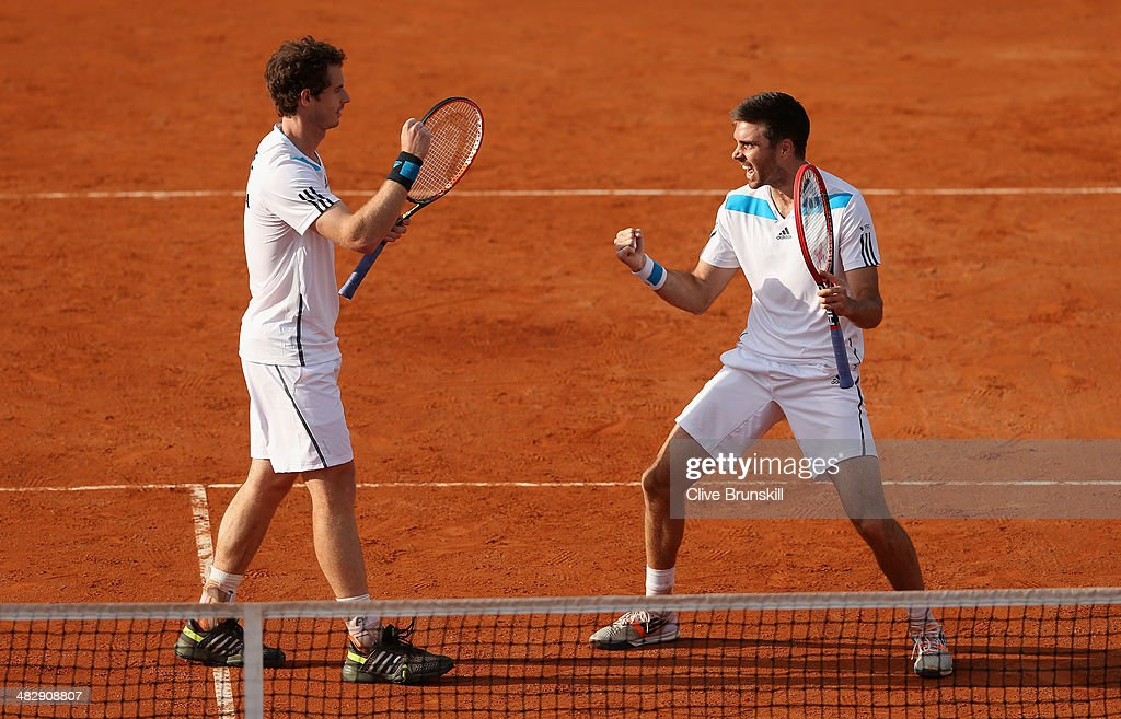Andy Murray and Colin Fleming of Great Britain celebrate match point against Simone Bolelli and Fabio Fognini of Italy during day two of the Davis Cup World Group Quarter Final match between Italy and Great Britain at Tennis Club Napoli on April 5, 2014 in Naples, Italy.