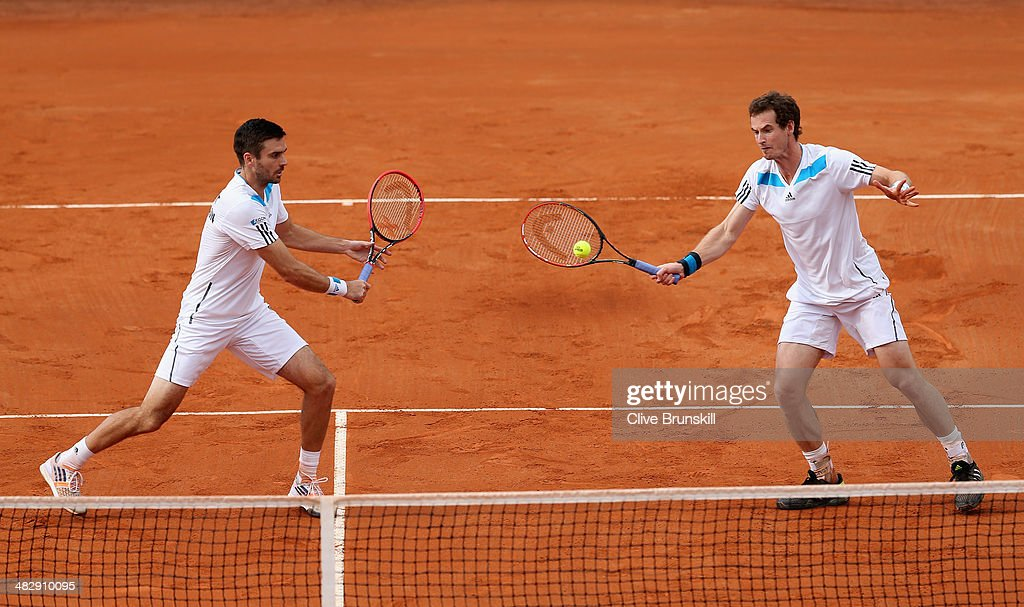 Andy Murray and Colin Fleming of Great Britain in action against Simone Bolelli and Fabio Fognini of Italy during day two of the Davis Cup World Group Quarter Final match between Italy and Great Britain at Tennis Club Napoli on April 5, 2014 in Naples, Italy.