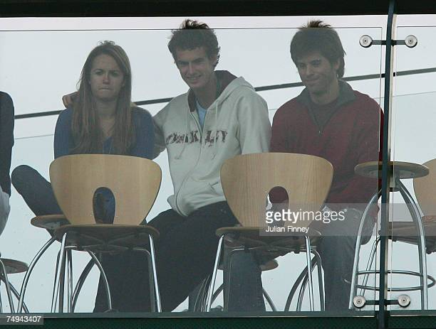 Andy Murray and girlfriend Kim Sears look on from the players lounge balcony during the Men's Doubles first round match between Jamie Murray of Great...