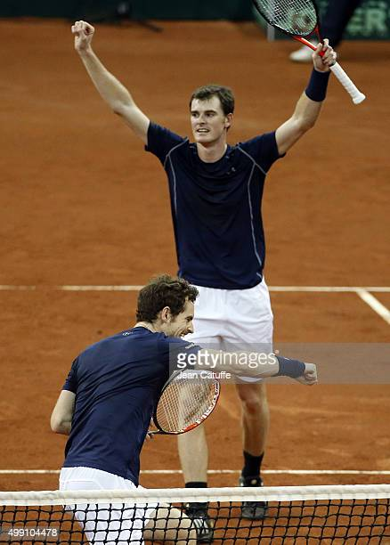 Andy Murray and his brother Jamie Murray of Great Britain celebrate winning the doubles match against David Goffin and Steve Darcis of Belgium during...