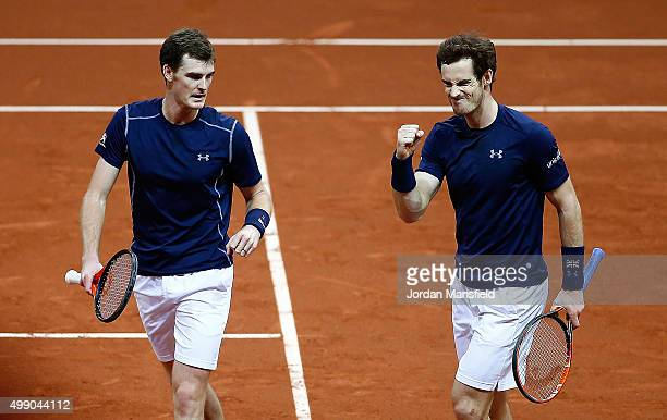 Andy Murray and Jamie Murray of Great Britain celebrate a break point during day two of the Davis Cup Final match between Belgium and Great Britain...