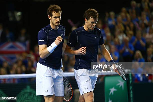 Andy Murray and Jamie Murray of Great Britain celebrate a point during the doubles match against Yoshihito Nishioka and Yasutaka Uchiyama of Japan on...