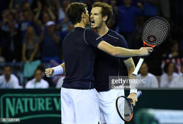 Andy Murray and Jamie Murray of Great Britain celebrate match point and a four set victory against Juan Martin Del Potro and Leonardo Mayer of...