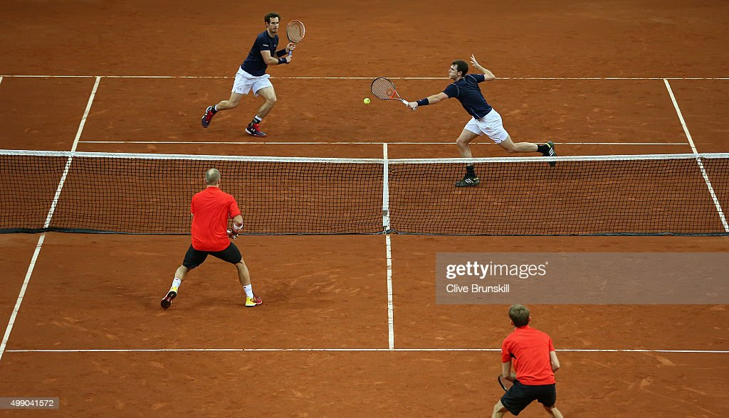 <a gi-track='captionPersonalityLinkClicked' href=/galleries/search?phrase=Andy+Murray+-+Tennis+Player&family=editorial&specificpeople=200668 ng-click='$event.stopPropagation()'>Andy Murray</a> and <a gi-track='captionPersonalityLinkClicked' href=/galleries/search?phrase=Jamie+Murray+-+Tennis+Player&family=editorial&specificpeople=4393751 ng-click='$event.stopPropagation()'>Jamie Murray</a> of Great Britain in action against <a gi-track='captionPersonalityLinkClicked' href=/galleries/search?phrase=Steve+Darcis&family=editorial&specificpeople=4354952 ng-click='$event.stopPropagation()'>Steve Darcis</a> and <a gi-track='captionPersonalityLinkClicked' href=/galleries/search?phrase=David+Goffin&family=editorial&specificpeople=2291768 ng-click='$event.stopPropagation()'>David Goffin</a> of Belgium during day two of the Davis Cup Final between Belgium and Great Britain at Flanders Expo on November 28, 2015 in Ghent, Belgium.