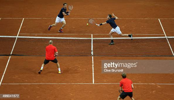 Andy Murray and Jamie Murray of Great Britain in action against Steve Darcis and David Goffin of Belgium during day two of the Davis Cup Final...