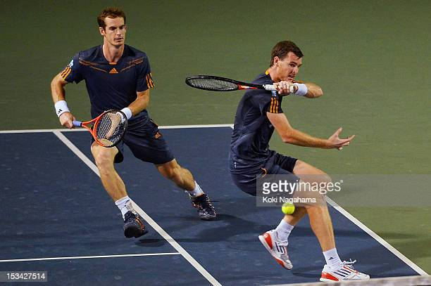 Andy Murray and Jamie Murray of Great Britain in action in their quater final match against Radek Stepanek of the Czech Republic and Leander Paes of...