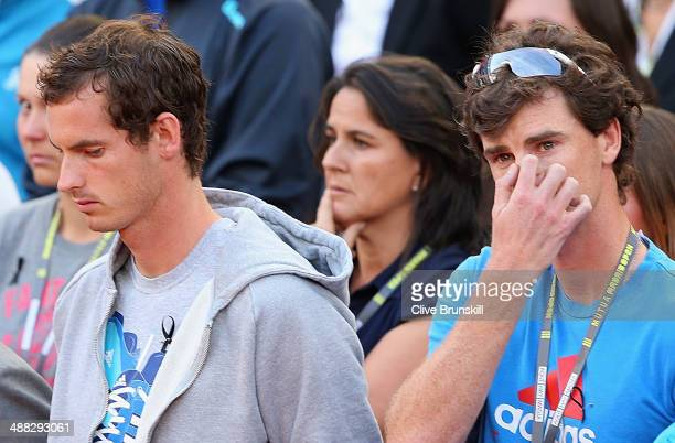 Andy Murray and Jamie Murray of Great Britain show their emotion as they stand for a minutes silence for former British tennis player Elena Baltacha...