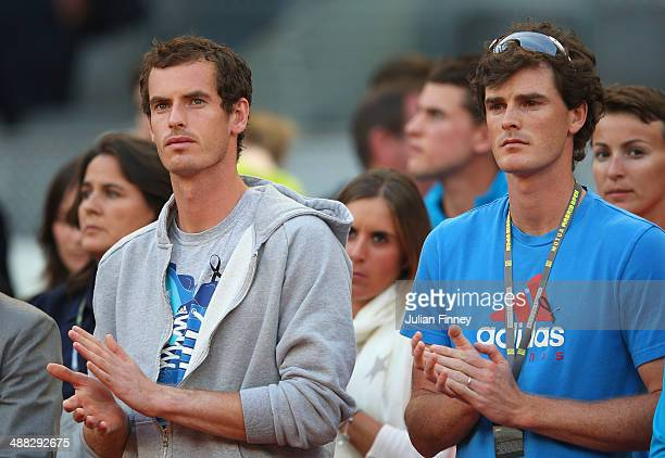 Andy Murray and Jamie Murray of Great Britain stand for a minutes silence after the news of former tennis player Elena Baltacha who died of liver...