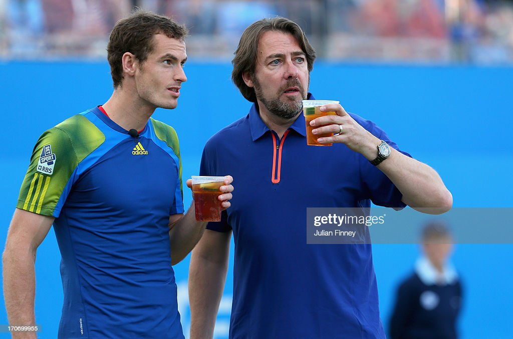 <a gi-track='captionPersonalityLinkClicked' href=/galleries/search?phrase=Andy+Murray+-+Tennis+Player&family=editorial&specificpeople=200668 ng-click='$event.stopPropagation()'>Andy Murray</a> and Jonathan Ross drink Pimms on the court during the Rally Against Cancer charity match on day seven of the AEGON Championships at Queens Club on June 16, 2013 in London, England.