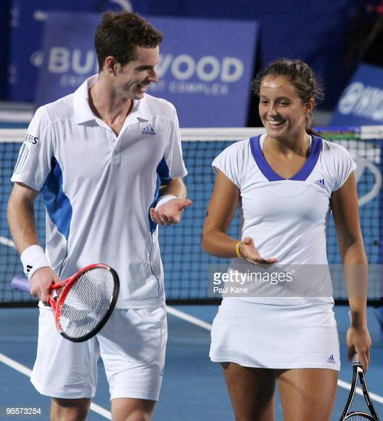 Andy Murray and Laura Robson of Great Britain talk tactics in their mixed doubles game against Yaroslava Shvedova and Andrey Golubev of Kazakhstan in...