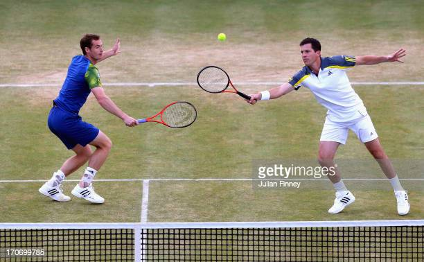 Andy Murray and Tim Henman in action during the Rally Against Cancer charity match on day seven of the AEGON Championships at Queens Club on June 16...