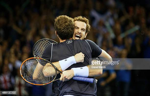 Andy Murray celebrates with his brother Jamie Murray as they beat Lleyton Hewitt and Sam Groth of Austrailier to put Great Britain 21 up in the Davis...