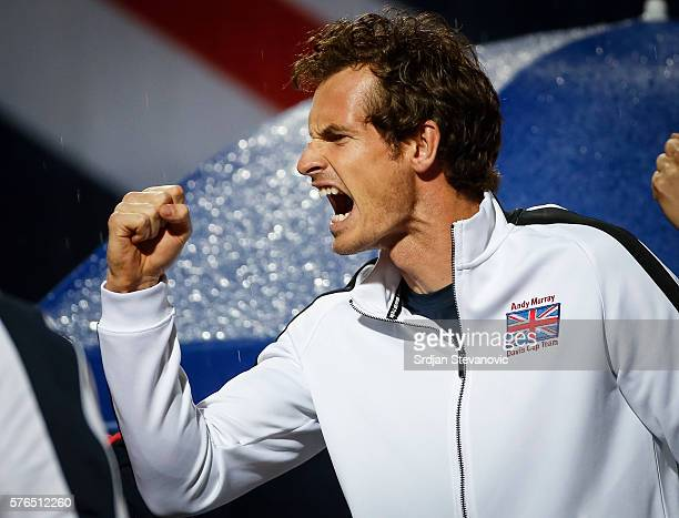 Andy Murray cheers Kyle Edmund of Great Britain during his match against Janko Tipsarevic of Serbia during the Davis Cup Quarter Final match between...