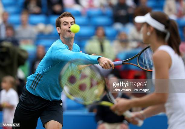 Andy Murray keeps his eye on the ball as he is watched by his doubles partner Martina Hingis in the rally for Bally exhibition match during the AEGON...