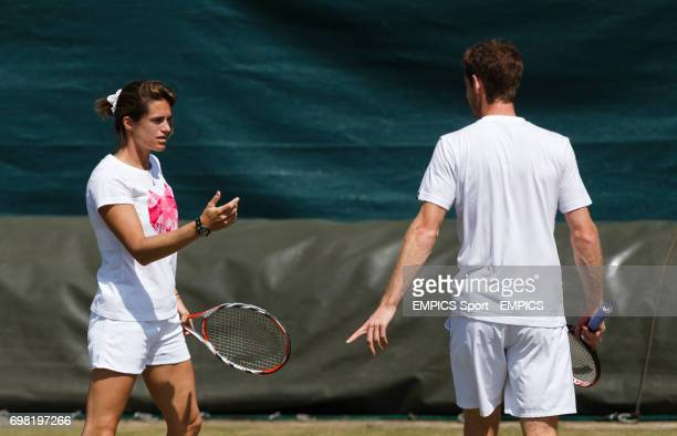 Andy Murray listens to his coach Amelie Mauresmo during the practice session