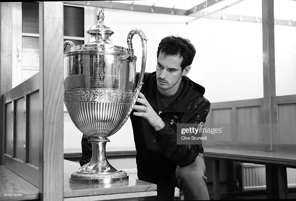 Andy Murray looks at the Aegon Championships trophy at The Queens Club Dressing Rooms on February 26, 2016 in London,United Kingdom. He will try to win the trophy for a record 5th time in June.
