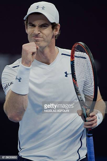 Andy Murray of Britain celebrates winning a point against Grigor Dimitrov of Bulgaria in their men's singles final match of the China Open tennis...
