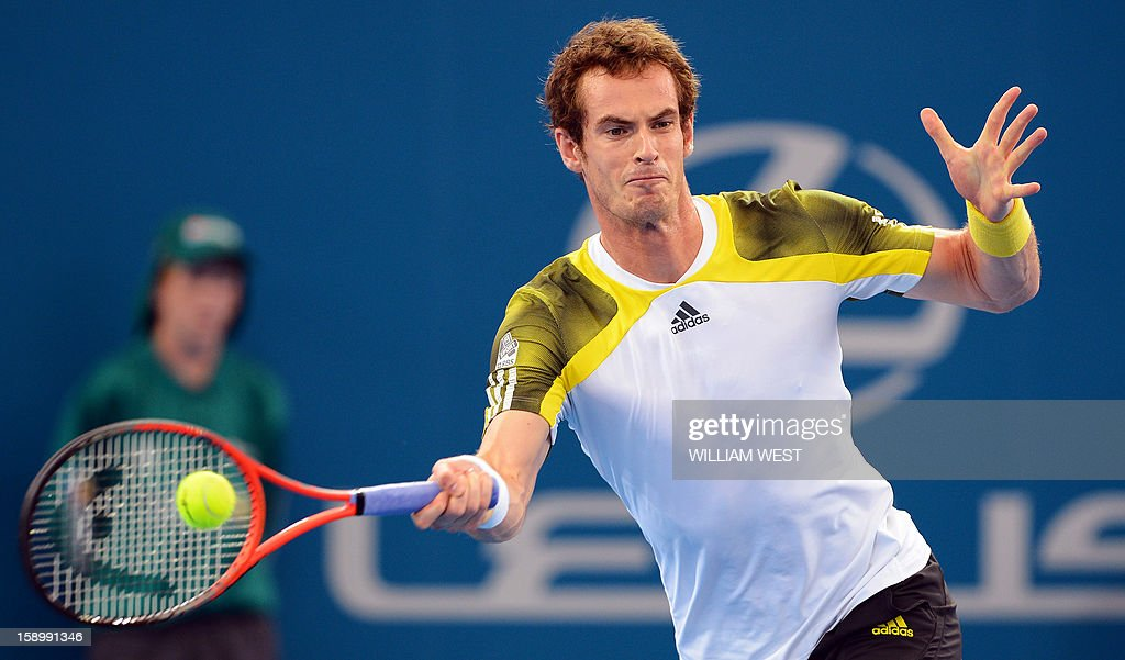 Andy Murray of Britain hits a backhand return in his semi-final match against Kei Nishikori of Japan at the Brisbane International tennis tournament on January 5, 2013. AFP PHOTO/William WEST USE