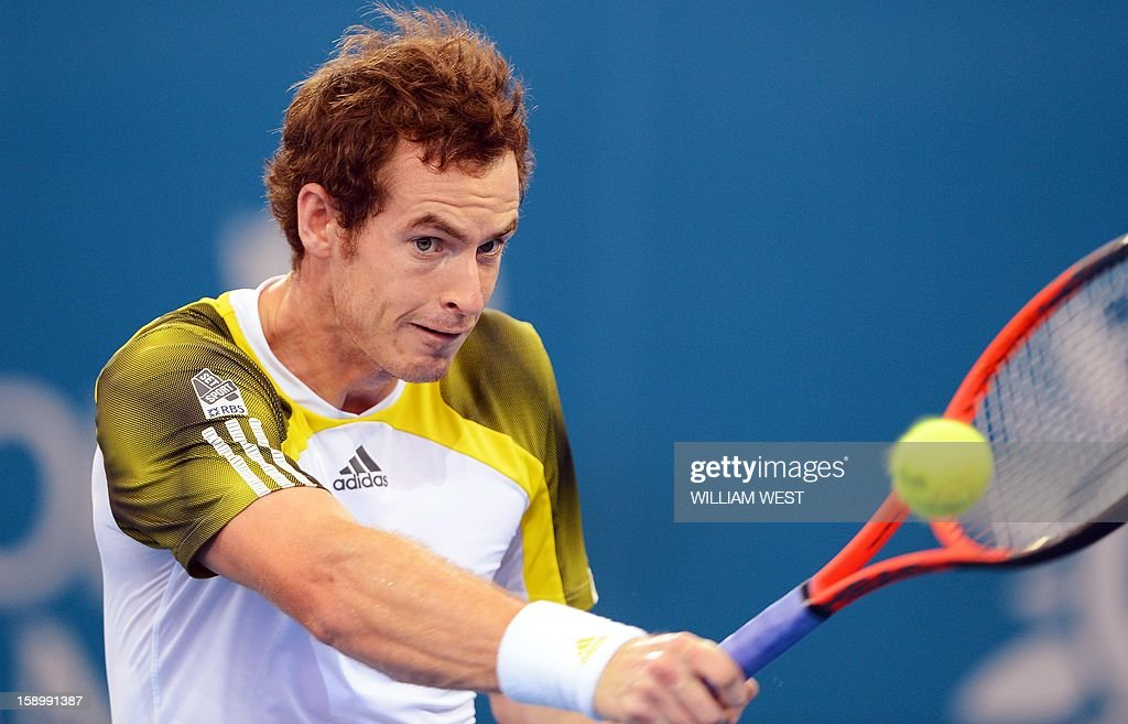 Andy Murray of Britain hits a backhand return in his semi-final match against Kei Nishikori of Japan at the Brisbane International tennis tournament, on January 5, 2013. AFP PHOTO/William WEST IMAGE RESTRICTED TO EDITORIAL USE - STRICTLY NO COMMERCIAL USE