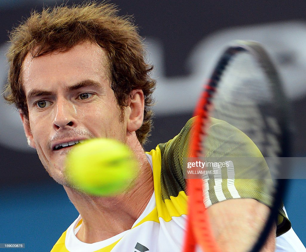 Andy Murray of Britain hits a backhand return on the way to defeating Grigor Dimitrov of Bulgaria in the final of the Brisbane International tennis tournament on January 6, 2013. AFP PHOTO/William WEST USE