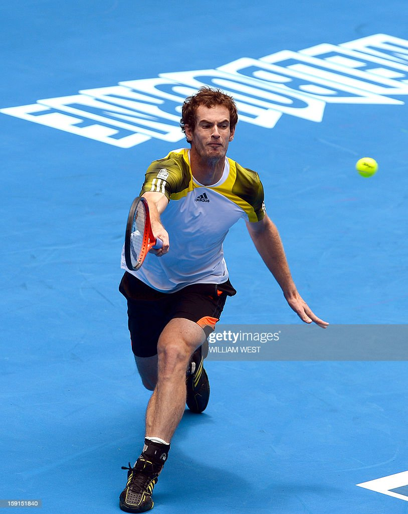 Andy Murray of Britain hits a forehand return during a training session at Melbourne Park on January 9, 2013. Top players are arriving in Melbourne ahead of the Australian Open which runs January 14-27. AFP PHOTO/William WEST IMAGE