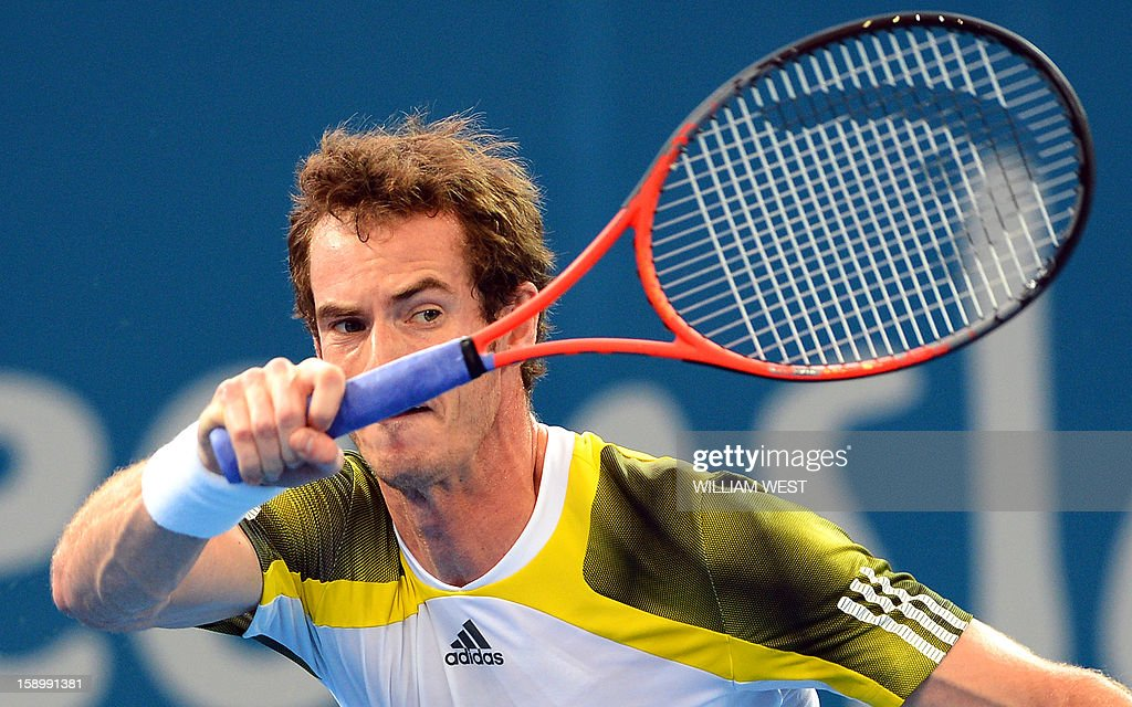 Andy Murray of Britain hits a forehand return in his semi-final match against Kei Nishikori of Japan at the Brisbane International tennis tournament, on January 5, 2013. AFP PHOTO/William WEST IMAGE RESTRICTED TO EDITORIAL USE - STRICTLY NO COMMERCIAL USE