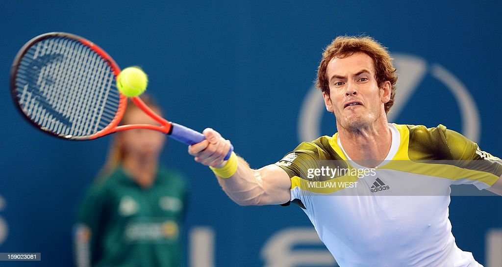 Andy Murray of Britain hits a forehand return on the way to defeating Grigor Dimitrov of Bulgaria in the final of the Brisbane International tennis tournament on January 6, 2013. AFP PHOTO/William WEST USE