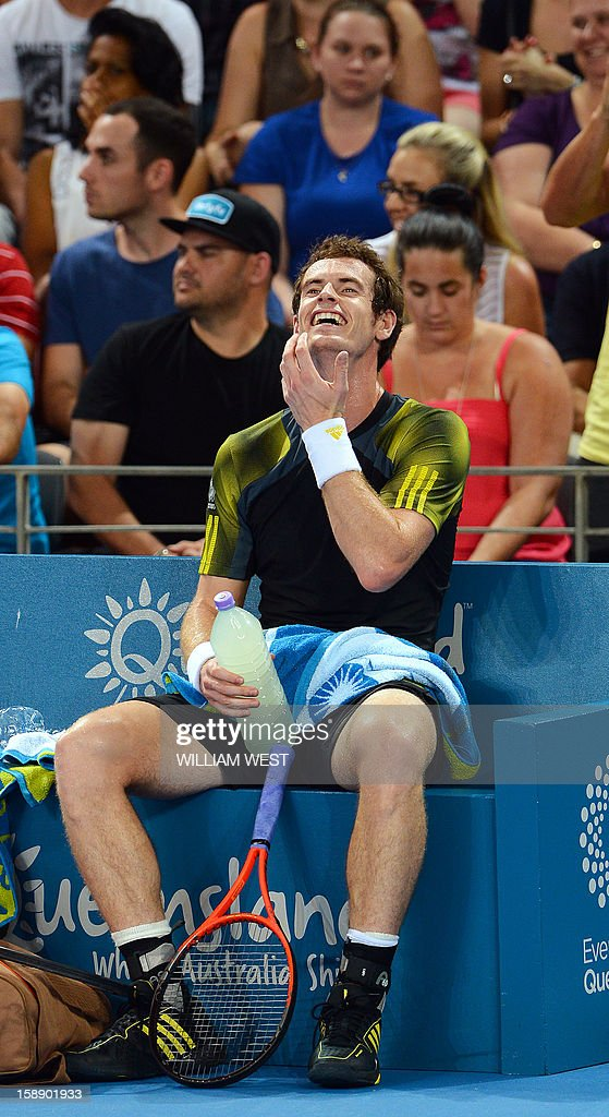 Andy Murray of Britain laughs after losing a game to John Millman of Australia in their second round match at the Brisbane International tennis tournament on January 3, 2013. AFP PHOTO/William WEST IMAGE RESTRICTED TO EDITORIAL USE - STRICTLY NO COMMERCIAL USE