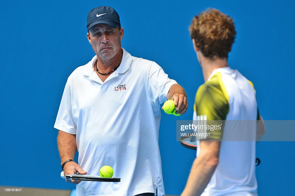 Andy Murray of Britain (R) listens to coach Ivan Lendl (L) during a training session at in Melbourne on January 9, 2013. Top players are arriving in Melbourne ahead of the Australian Open which runs January 14-27. AFP PHOTO/William WEST IMAGE